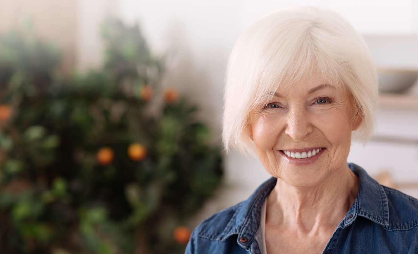 Older woman with denture smiling