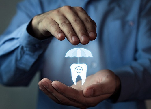Man holding animated tooth under an umbrella
